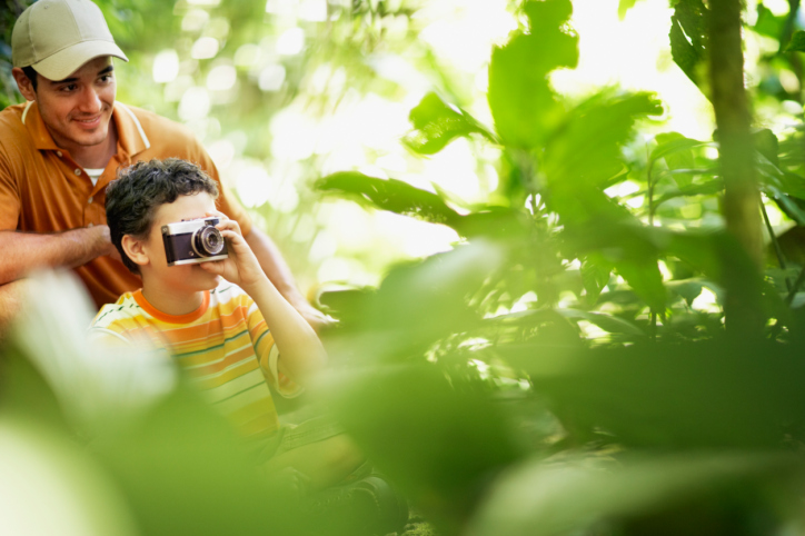 Father and Son in Wilderness Area Taking Picture